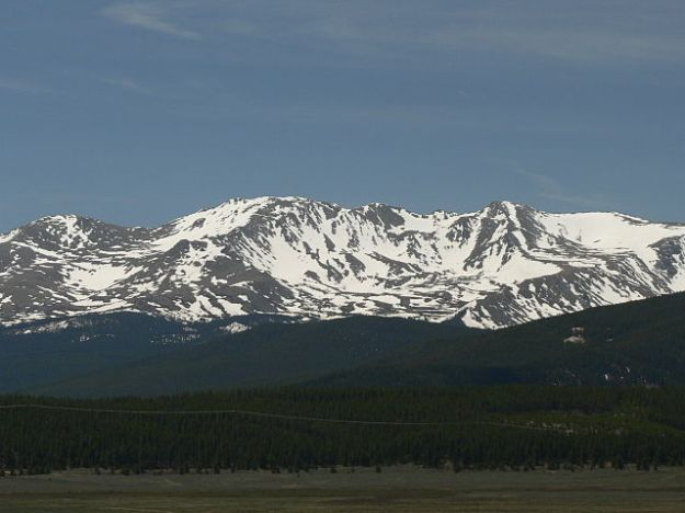 Mount Massive in the Sawatch Range of Colorado, via Wikimedia Commons. I wrote this little essay a few years ago, during a snowier winter than the one we're having this year in the central US, and I neglected to take a comparative photo of Mt. Not-So-Massive beside my driveway. Use your imagination.