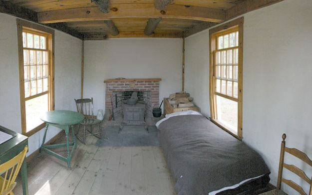 Inside the reconstruction of Thoreau's cabin at Walden Pond. Wikimedia Commons