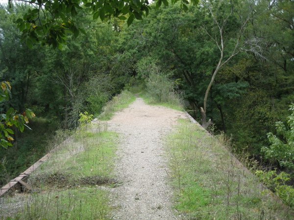 An abandoned Rock Island Railway bridge in Wilderness Park, Lincoln, Nebraska, now used by bikers and hikers.