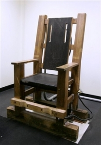 """Nebraska's electric chair."" (AP Photo/Nati Harnik) Licensed under Fair use via Wikipedia - http://en.wikipedia.org/wiki/File:Nebraska%27s_electric_chair.JPG#mediaviewer/File:Nebraska%27s_electric_chair.JPG"